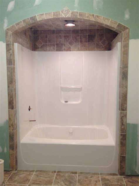 Bathtub Tile Like The Idea Of Tile Around And Above. Sherwin Williams Sensible Hue. Sea Glass Tile. Curved Bar. Old Fashioned Chandelier. Modern Candle Wall Sconces. Cool Shower. Landscape Design Software For Mac. Silk Wallpaper