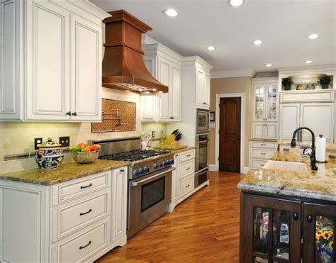 Traditional White Kitchen with Copper Range Hood ..I