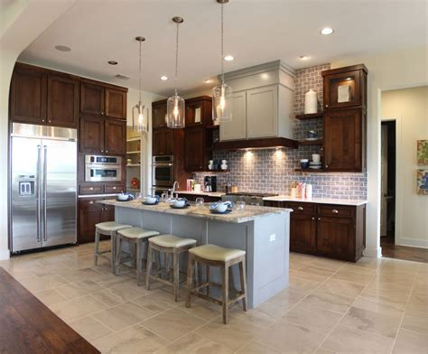 Oak Kitchen Island - should cabinets match throughout house burrows cabinets central texas builder direct custom