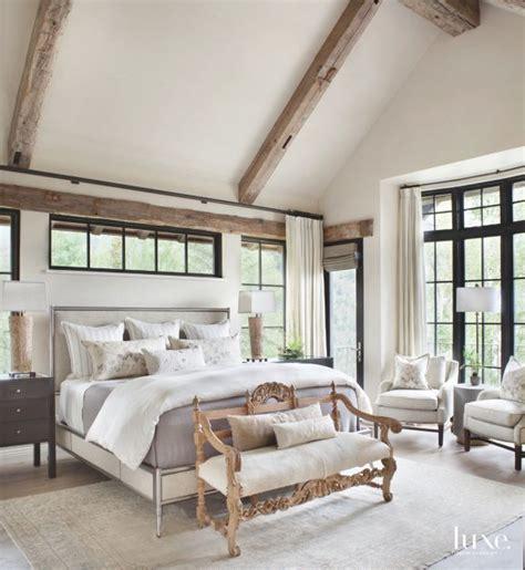 beam master bedroom  high windows bench loveseat