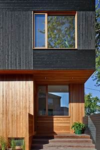 black siding with wood accents for this toronto home