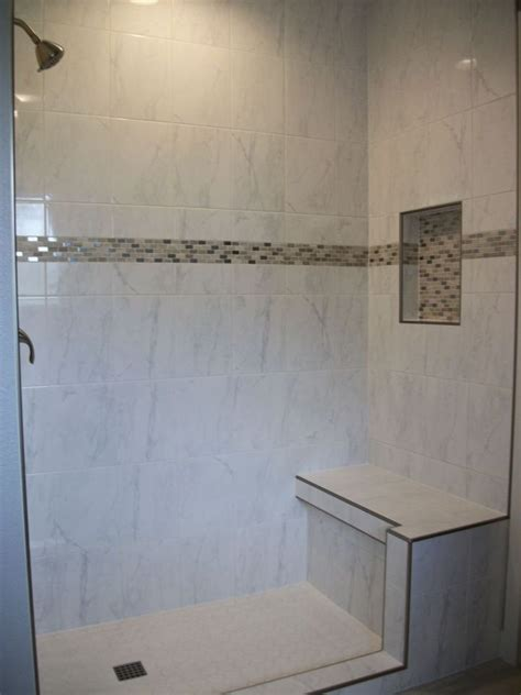 white ceramic tile shower  accent band  nickel