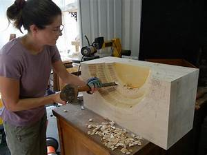 Mary May carving the shell niche - Mary May - Woodcarver