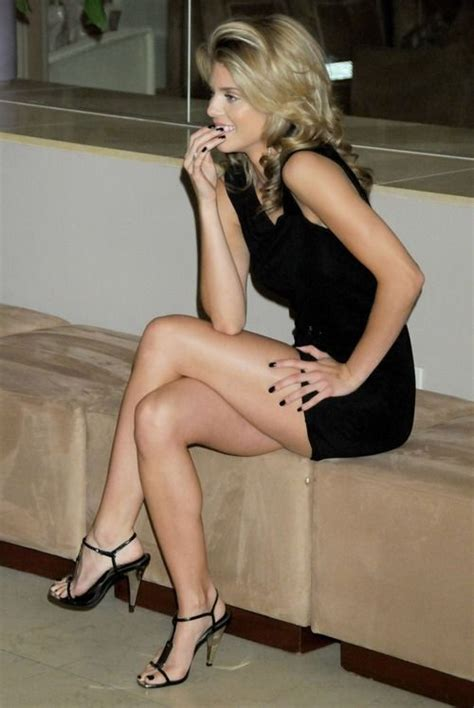 A Blonde With Black Dress Black Heels And Black Nails
