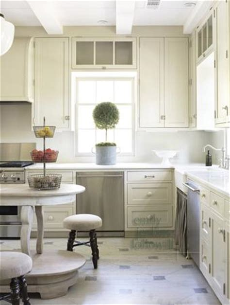 cream backsplash with white cabinets cream kitchen cabinets cottage kitchen emily