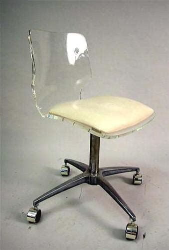 a lucite desk chair with beige vinyl seat and chrome base