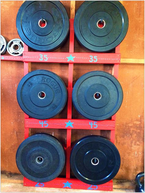 crossfit home gym diy bumper plate rack  studs xs xs  long eye hooks paint