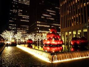 giant red ornaments and holiday decorations on 6th ny through the lens new york city