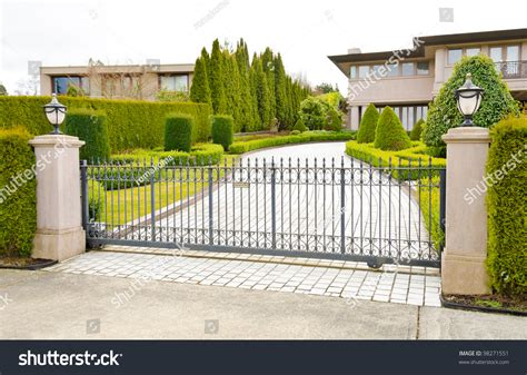 fancy entrance gates driveway luxury house behind gates suburbs stock photo 98271551 shutterstock