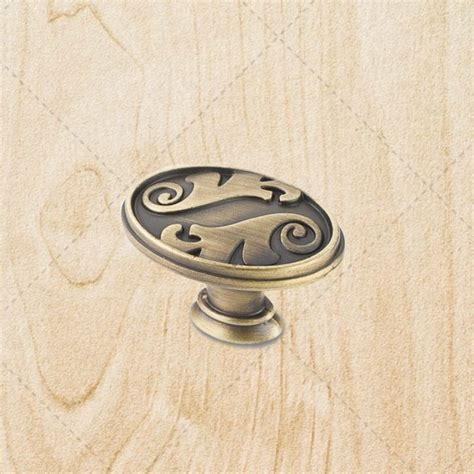 antique brass knobs for kitchen cabinets kitchen cabinet oval knobs ku097 brushed antique brass