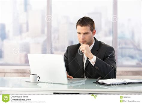 Young Manager Working On Laptop In Office Stock Photos