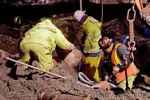utility workers fixing broken water main, san francisco