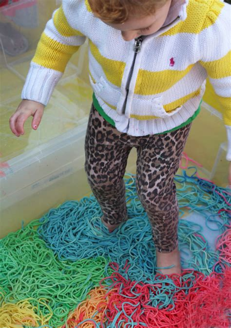 rainbow spaghetti sensory play  babies  toddlers