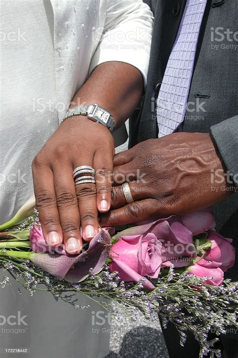 In this video, i cover my essential tips and knowledge of posing hands and arms. African American Wedding Hands Stock Photo - Download ...
