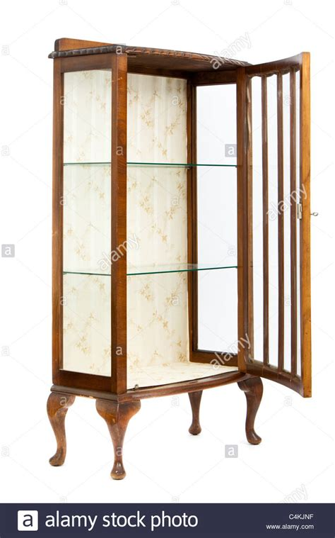 antique glass door cabinet antique walnut and glass display cabinet stock photo 4087