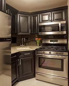 small kitchen with black cabinets and stainless appliances 2090