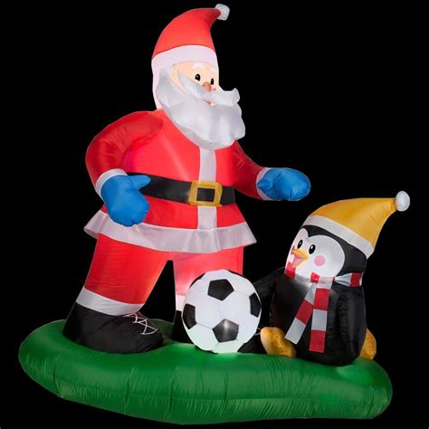 home accents holiday  ft inflatable santa soccer scene