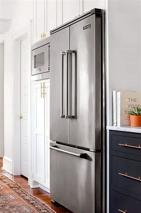 Glass cabinets are often paired with wood cabinets to add texture and color variation to a space. 32 Kitchen Cabinets Around Refrigerator for more Storage Space