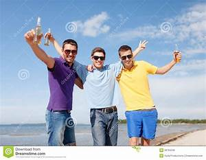 Friends Having Fun On Beach With Bottles Of Beer Stock ...
