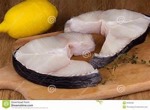 Shark Steak With Lemon On A Chopping Board Stock ...
