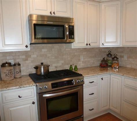 travertine kitchen backsplash colonial gold granite and tumbled travertine backsplash
