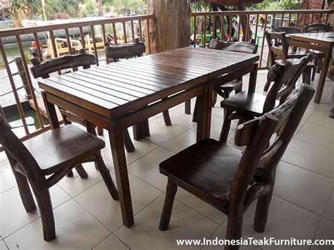 teak wood chairs and table set suitable for restaurant or