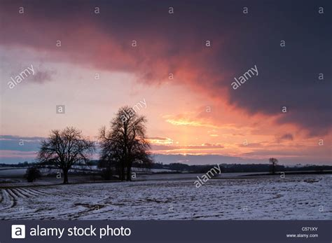 Winter Storm Clouds Encroaching On The Warm Colours Of