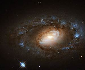 Hubble Spies Charming Spiral Galaxy Bursting with Stars | NASA