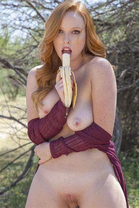 Naughty Nude Redhead Eating Banana Outdoor June