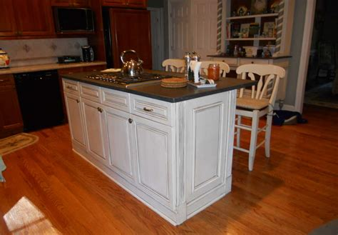 white island kitchen kitchen cabinet island with white color and black top