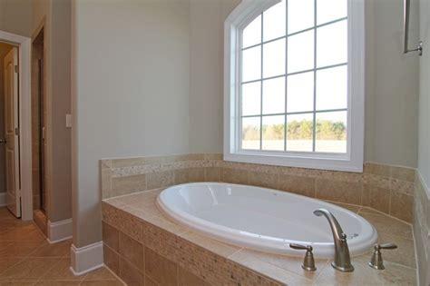 soaking tub rustic bathroom raleigh by stanton homes