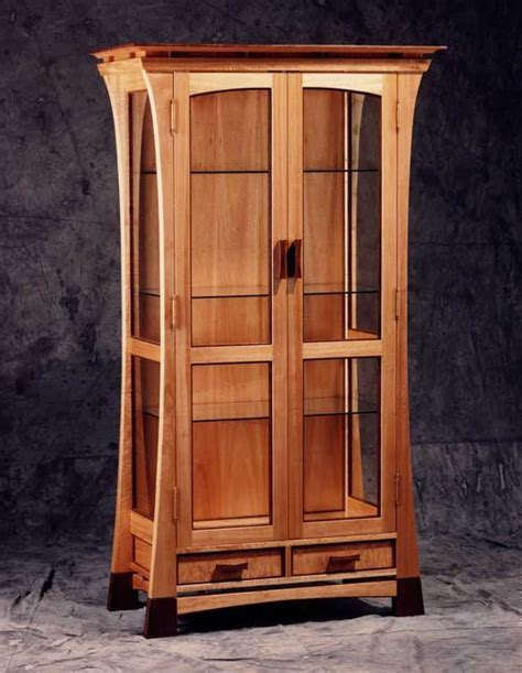 tall glass front cabinet curio cabinet a tall and skinny cabinet with glass doors