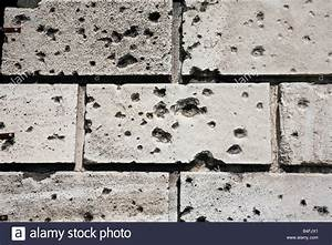 Bullet holes in a wall Stock Photo, Royalty Free Image ...