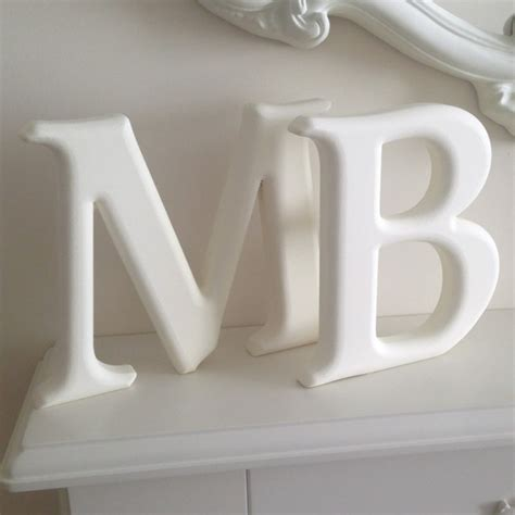 carved rounded freestanding wooden letters