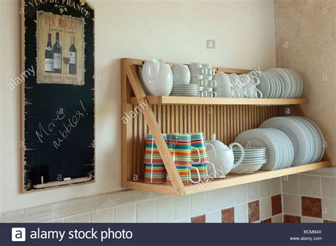 close   notice board  wall  wooden plate rack  stock photo  alamy