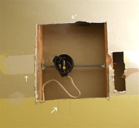 installing bathroom light fixture install light fixture between studs diy how to and tips