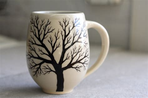 white ceramic ls belly tree mug pottery coffee cup with painted tree in