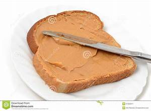 Spreading Peanut Butter On Bread - Image Mag