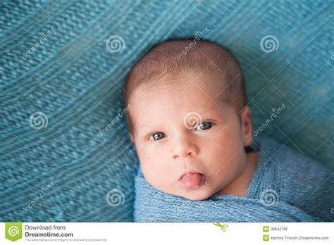 Newborn Baby Boy Sticking Out His Tongue Royalty Free