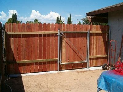 wood fence  metal post  gate   inches wide