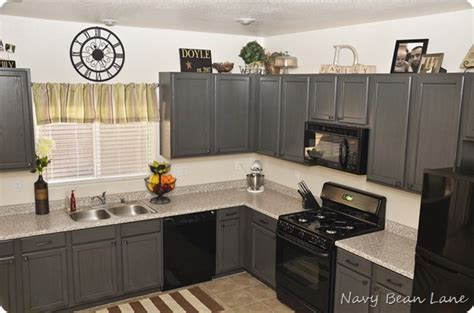 grey kitchen cabinets with black appliances navy bean gray kitchen cabinets before after 8358