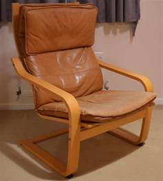 ikea poang chair tan leather cushion and footstool