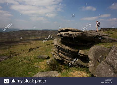 Lone Lady Walker On Stanage Edge Gritstone Cliffs, Peak