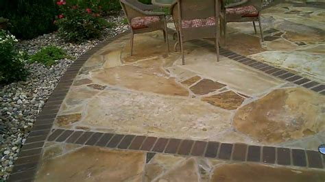 flagstone patio with brick border by josh link