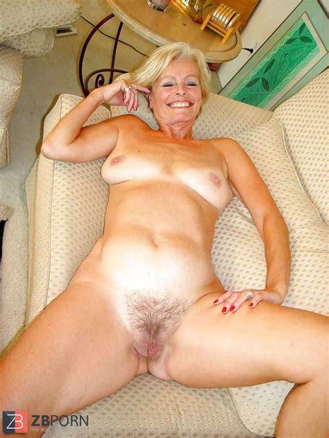 Justine A Mature Platinum Blonde Disrobing In The Living