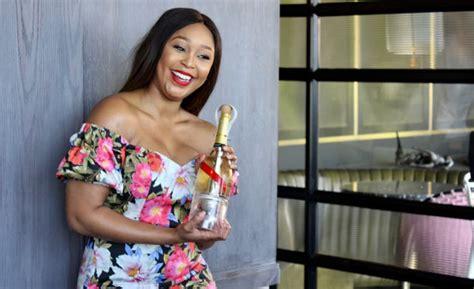 minnie dlamini jones drinks champagne  space