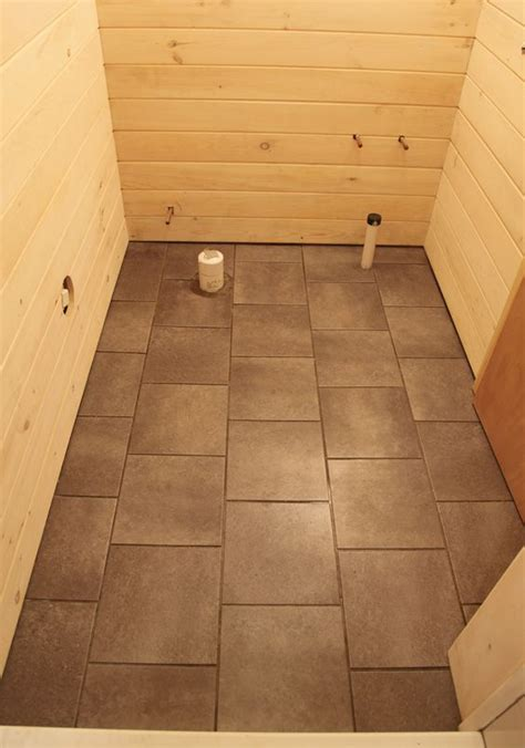 how to stagger vinyl plank flooring staggered tile pattern our basement part 33 installing vinyl faux slate flooring whitewash