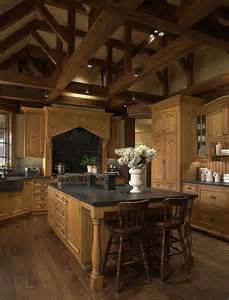singular tone of wood cabinetry unifies this kitchen sandwiched between exposed