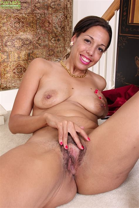 latina mom josephine jones letting red dress slip away to expose breasts