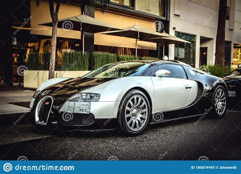 The bugatti veyron key is the exact same one they give you with a vw jetta/passat/gti etc. Front View Of A Bugatti Veyron Parked In The Street. Editorial Image - Image of beautiful ...